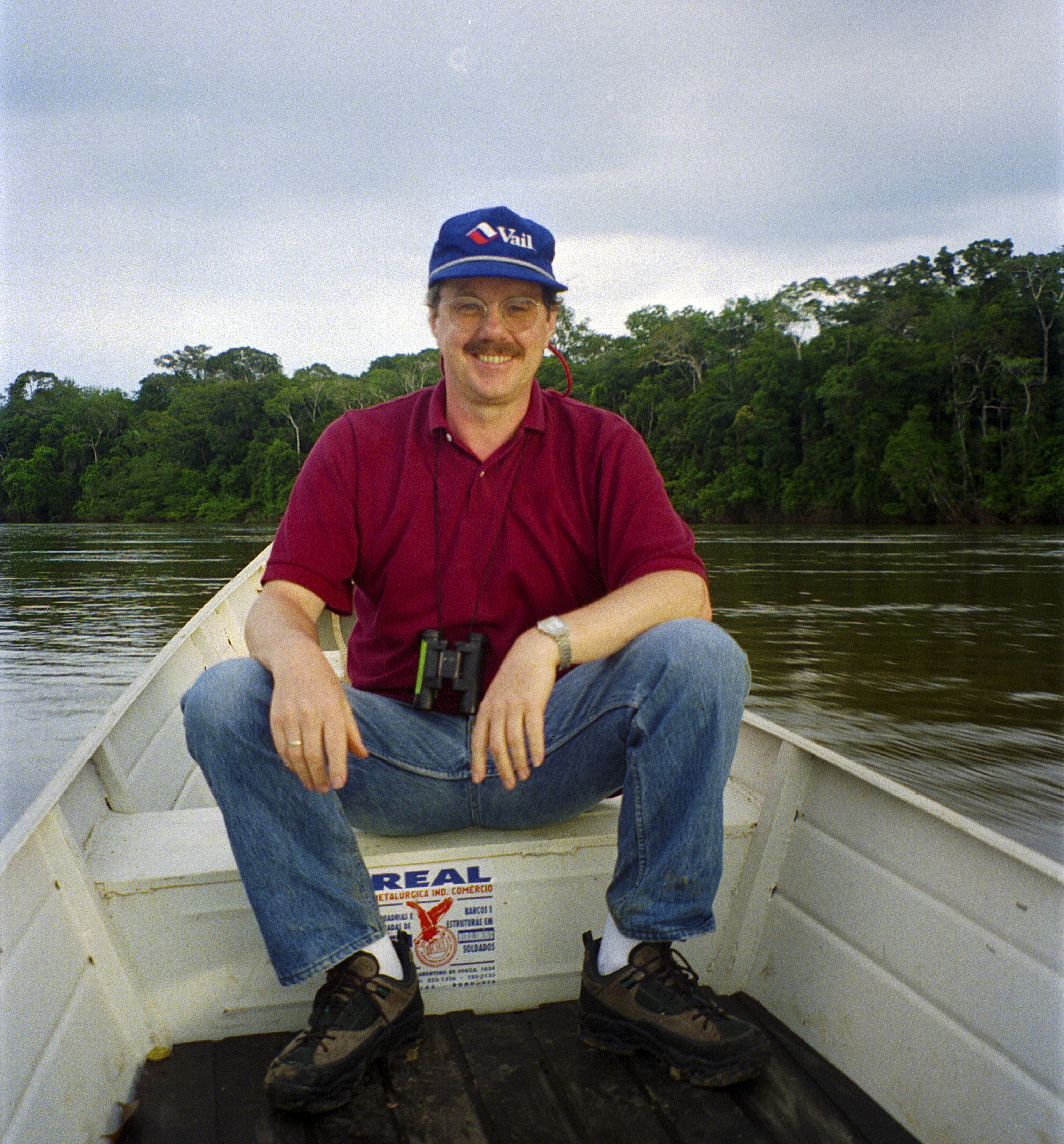 """<span  class=""""uc_style_uc_tiles_grid_image_elementor_uc_items_attribute_title"""" style=""""color:#ffffff;"""">Meinrat Andreae in the Amazon in 1999, on the Jaru River.</span>"""