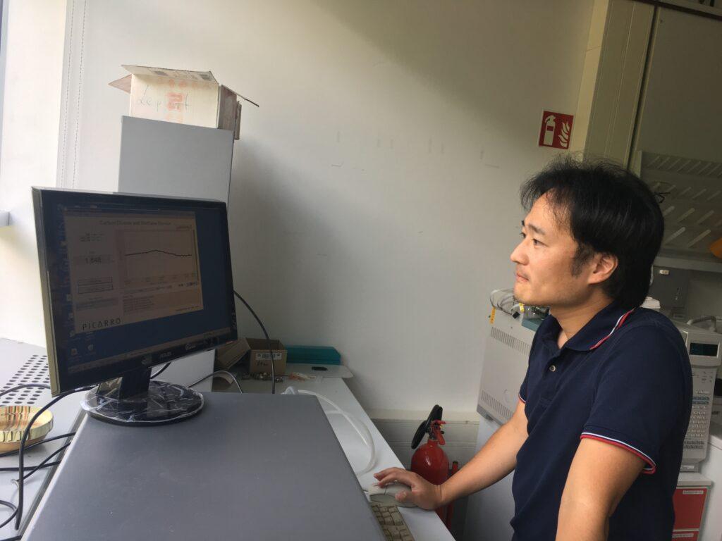 Komi checking data in the lab.