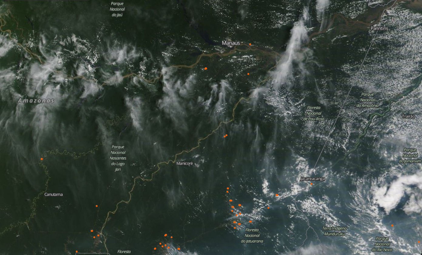 Smoke from biomass burning rises into the atmosphere over the central Amazon basin. © NASA
