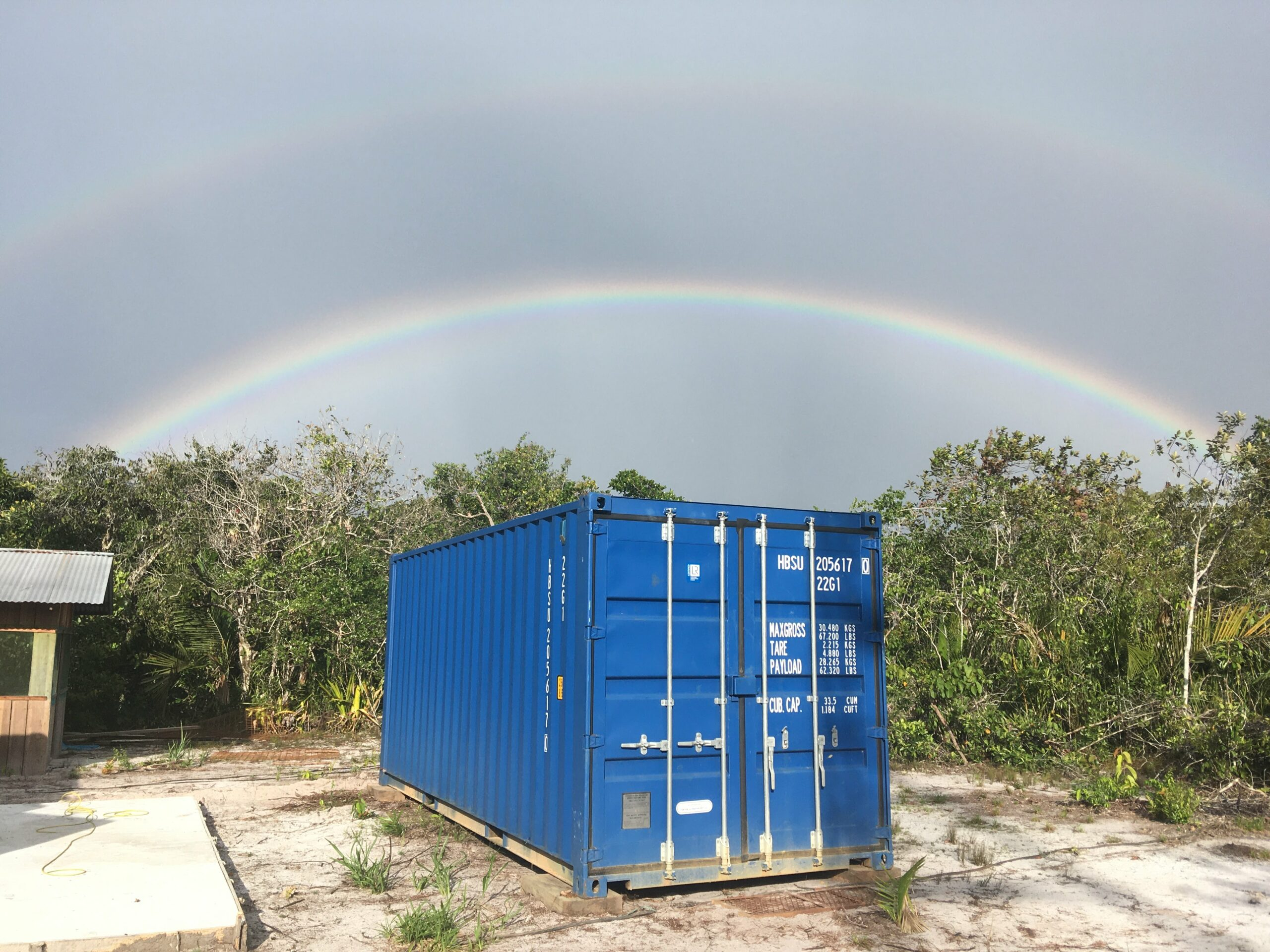 """Double-rainbow just above the storage container in the only """"rainy"""" (actually it was just some drizzle) day when we were working on the site."""