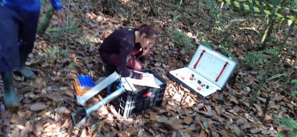 Ana Caroline collects soil water samples