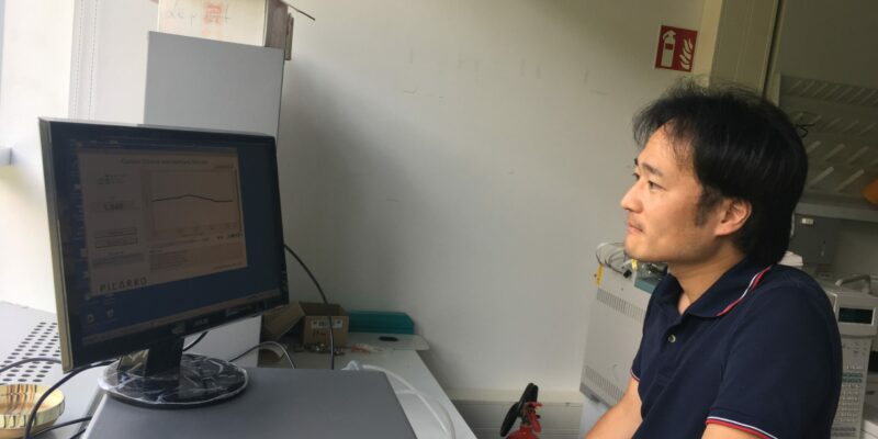 Komi checking data in the lab.